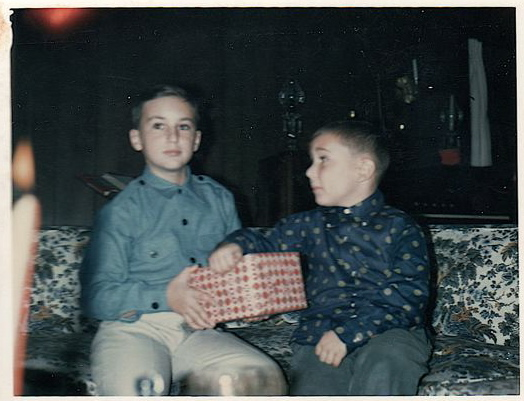 Chris (on the right) and his brother Andy (on the left). Note the bold fashion statement shirts.