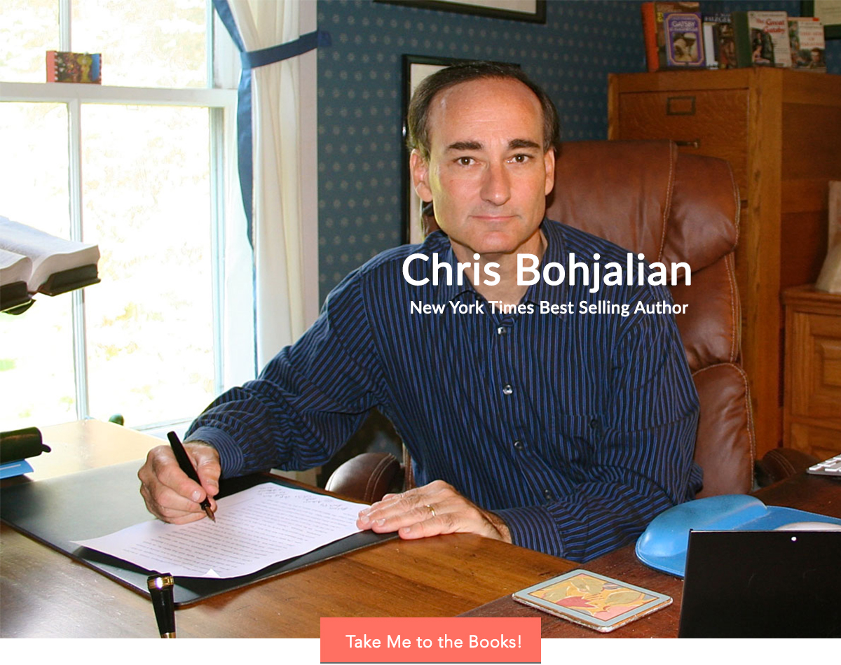Chris Bohjalian at desk writing